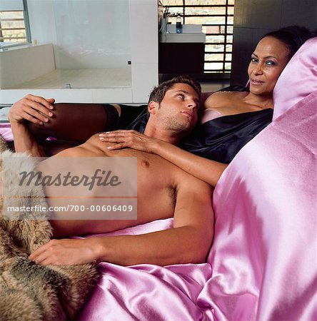 Couple Lounging In Bed Stock Photo - Rights-Managed, Image code: 700-00606409