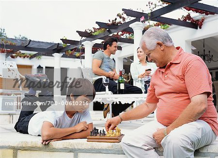 Grandfather and Grandson Playing Chess Stock Photo - Rights-Managed, Image code: 700-00610216