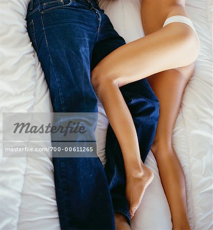 Couple In Bed From The Waist Down