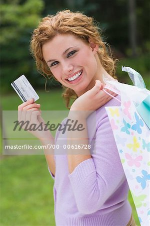 Portrait of Woman with Shopping Bag and Credit Card
