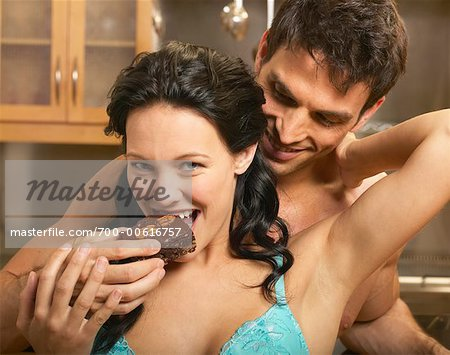 Man Feeding Woman Brownie Stock Photo - Rights-Managed, Image code: 700-00616757
