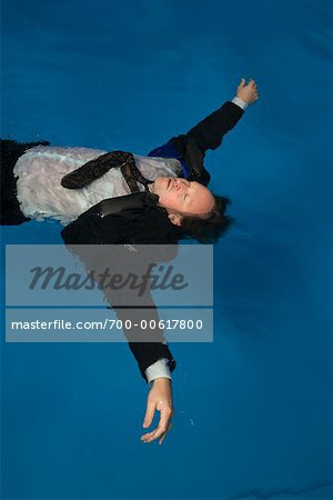 Businessman Floating in Swimming Pool Stock Photo - Rights-Managed, Image code: 700-00617800