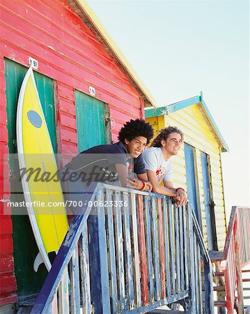 Friends by Beach Hut with Surfboard Stock Photo - Rights-Managed, Image code: 700-00623336