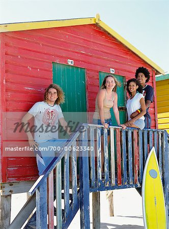 Friends by Beach Hut with Surfboard Stock Photo - Rights-Managed, Image code: 700-00623340