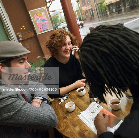 Three Young People Having Tea At A Cafe Stock Photo - Rights-Managed, Image code: 700-00634100