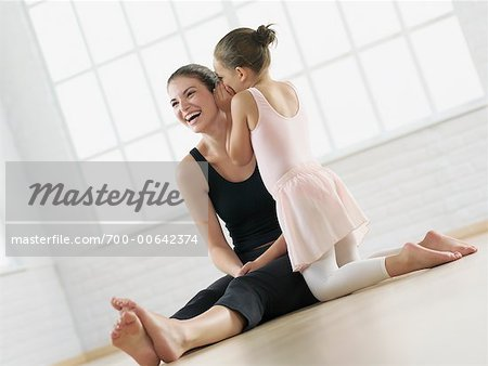 Ballet Student Whispering In Instructor's Ear
