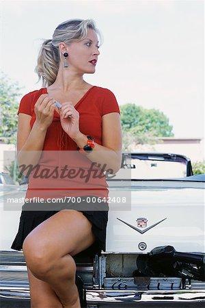 Woman Putting Gas in Car