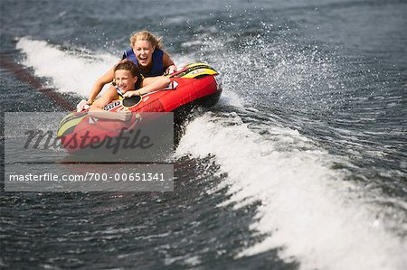 Two Girls Riding in Tube Stock Photo - Rights-Managed, Image code: 700-00651341