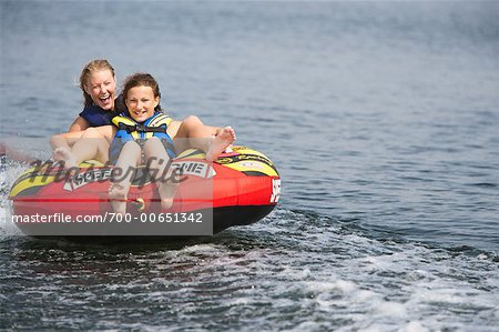 Two Girls Inner Tubing Stock Photo - Rights-Managed, Image code: 700-00651342