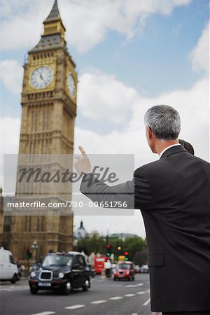 Businessman Hailing Taxi, London, England Stock Photo - Rights-Managed, Image code: 700-00651756