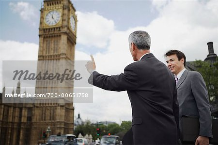 Businessmen Hailing Taxi, London, England Stock Photo - Rights-Managed, Image code: 700-00651758