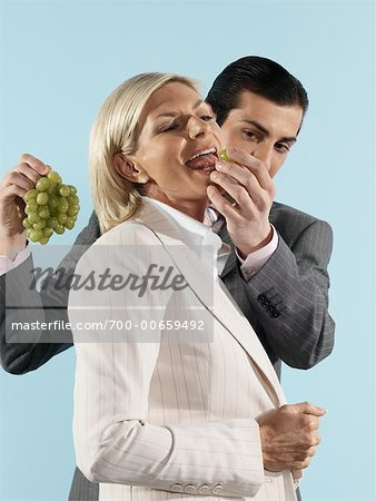 Businessman Feeding Grapes to Businesswoman Stock Photo - Rights-Managed, Image code: 700-00659492