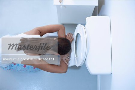 Woman Vomiting Stock Photo - Rights-Managed, Image code: 700-00661131