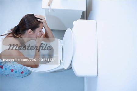 Woman Vomiting Stock Photo - Rights-Managed, Image code: 700-00661132