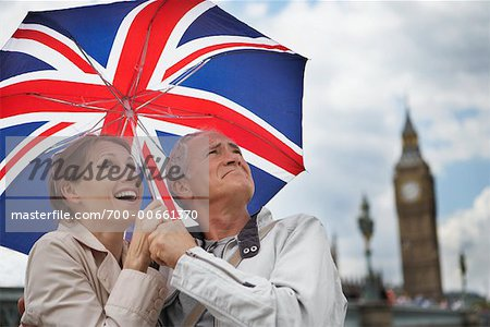 Couple Holding Umbrella, London, England Stock Photo - Rights-Managed, Image code: 700-00661370