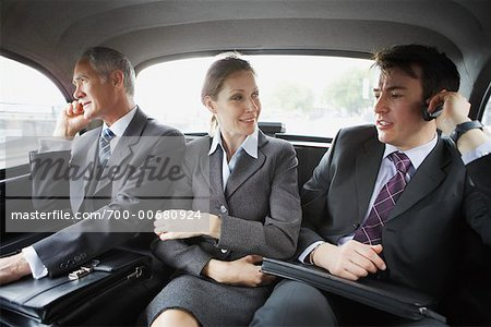 Business People Riding In the Back of A Cab Stock Photo - Rights-Managed, Image code: 700-00680924