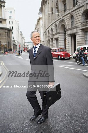 Businessman Crossing Street Stock Photo - Rights-Managed, Image code: 700-00680925