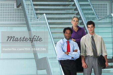 Portrait of Business People Standing on Stairs