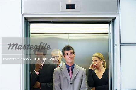 Business People on Elevator Smelling Unpleasant Odor Stock Photo - Rights-Managed, Image code: 700-00681396