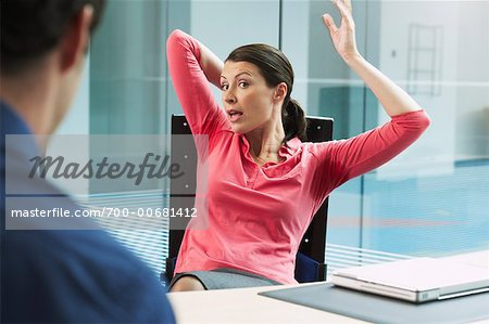 Businesswoman with Underarm Perspiration Marks, Sitting at Desk Stock Photo - Rights-Managed, Image code: 700-00681412
