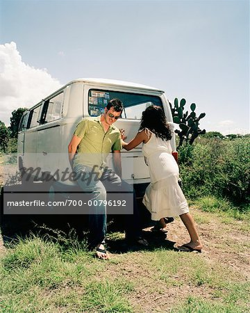 Couple Pushing Stalled Van Stock Photo - Rights-Managed, Image code: 700-00796192