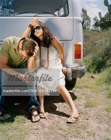 Couple Sitting on Back of Van, Looking Upset Stock Photo - Rights-Managed, Image code: 700-00796194