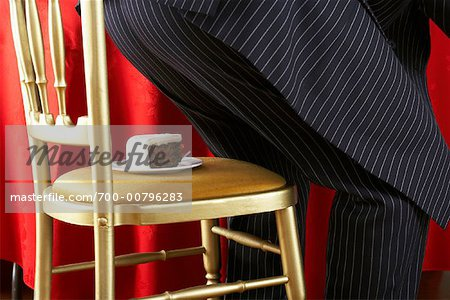 Man About to Sit on Piece of Cake Stock Photo - Rights-Managed, Image code: 700-00796283