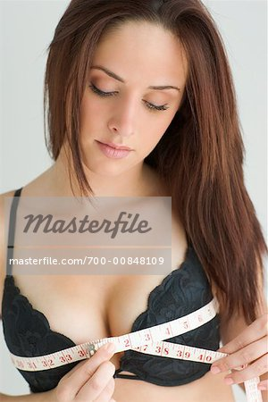 Woman Measuring Breasts Stock Photo - Rights-Managed, Image code: 700-00848109