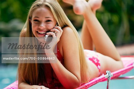 Girl Using Cellular Phone Stock Photo - Rights-Managed, Image code: 700-00864843