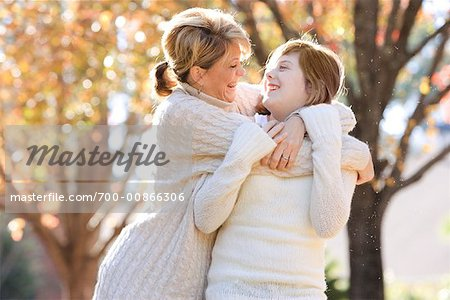 Mother Hugging Daughter, Outdoors Stock Photo - Rights-Managed, Image code: 700-00866306