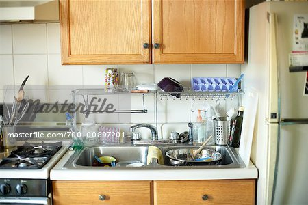 Kitchen with Dishes in the Sink Stock Photo - Rights-Managed, Image code: 700-00897201