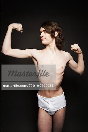 Man Flexing Muscles Stock Photo - Rights-Managed, Image code: 700-00910161