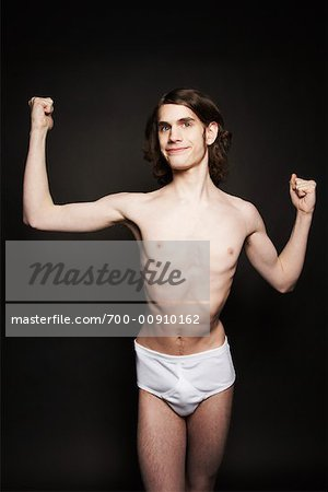 Man Flexing Muscles Stock Photo - Rights-Managed, Image code: 700-00910162