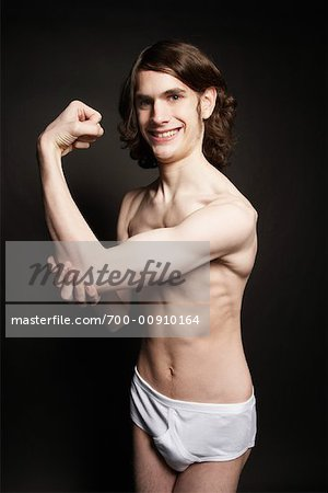 Man Flexing Muscles Stock Photo - Rights-Managed, Image code: 700-00910164