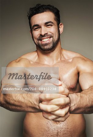 Man Flexing Muscles Stock Photo - Rights-Managed, Image code: 700-00910238