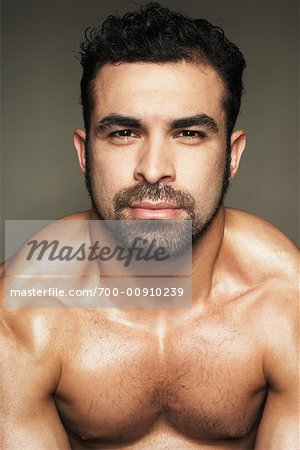 Man Flexing Muscles Stock Photo - Rights-Managed, Image code: 700-00910239