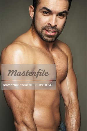Man Flexing Muscles Stock Photo - Rights-Managed, Image code: 700-00910242