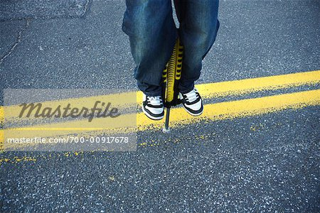 Close Up of Boy Jumping On a Pogo Stick Stock Photo - Rights-Managed, Image code: 700-00917678
