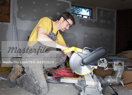 Man Using Saw