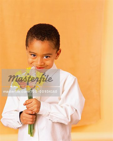 Child Holding Flowers Stock Photo - Rights-Managed, Image code: 700-00934160