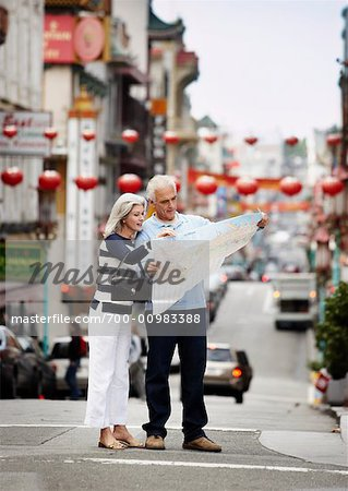 Couple Looking at Map in Street, Chinatown, Kearny Street, California, USA Stock Photo - Rights-Managed, Image code: 700-00983388