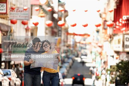 Couple Looking at Map in Street, Kearny Street, Chinatown, San Francisco, California, USA Stock Photo - Rights-Managed, Image code: 700-00983400