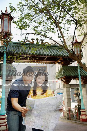 Couple Looking at Map in Street, Chinatown, San Francisco, California, USA Stock Photo - Rights-Managed, Image code: 700-00983411