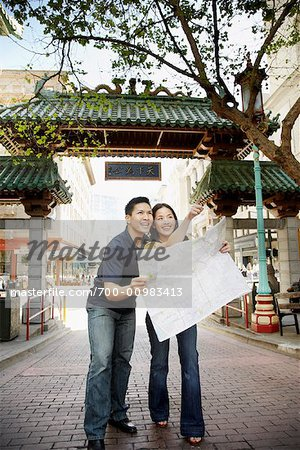 Couple Looking at Map in Street, Chinatown, San Francisco, California, USA Stock Photo - Rights-Managed, Image code: 700-00983413