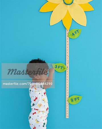 Portrait of Boy by Growth Chart Stock Photo - Rights-Managed, Image code: 700-00984290