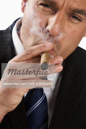 Businessman Smoking Cigar Stock Photo - Rights-Managed, Image code: 700-01015006