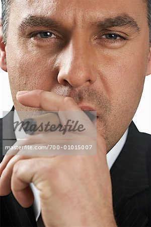 Businessman Smoking Cigar Stock Photo - Rights-Managed, Image code: 700-01015007