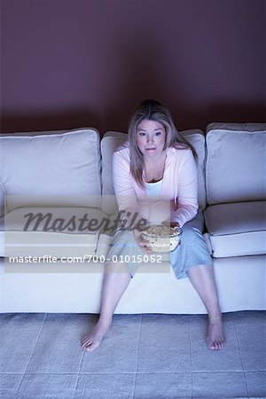 Woman with Popcorn Watching Television Stock Photo - Rights-Managed, Image code: 700-01015052