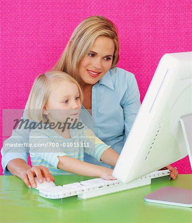 Mother and Daughter Using Computer Stock Photo - Rights-Managed, Image code: 700-01015311