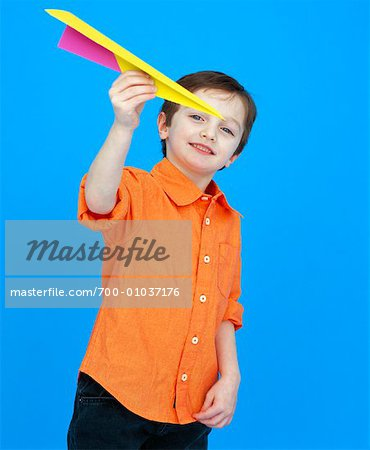 Boy Playing With Paper Airplane Stock Photo - Rights-Managed, Image code: 700-01037176